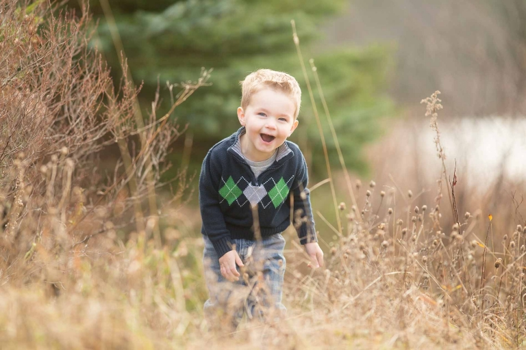 boy laughing in field