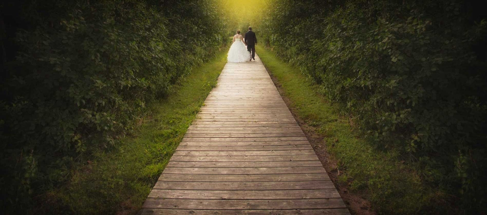 newlyweds walking on boardwalk