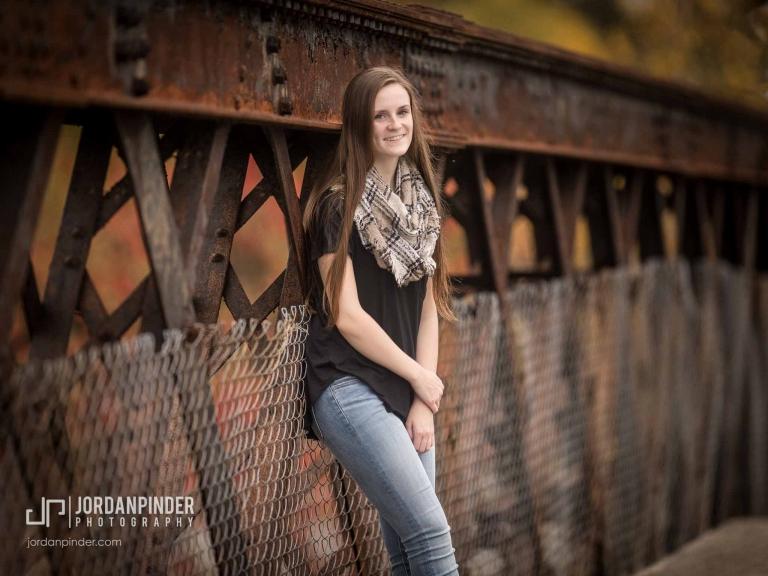 girl on rusty bridge