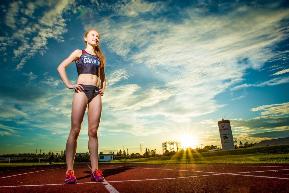 track and field athlete standing on track in Miramichi