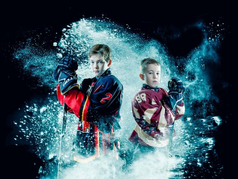 Miramichi hockey players in snow spray