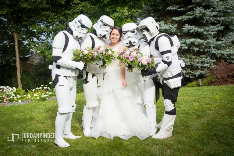 bride posing with stormtroopers during wedding photography