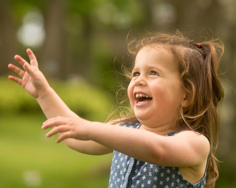 girl laughing during spring family photography session